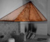 foto del prodotto Cappe in rame per caminetto - sagomatura radiale